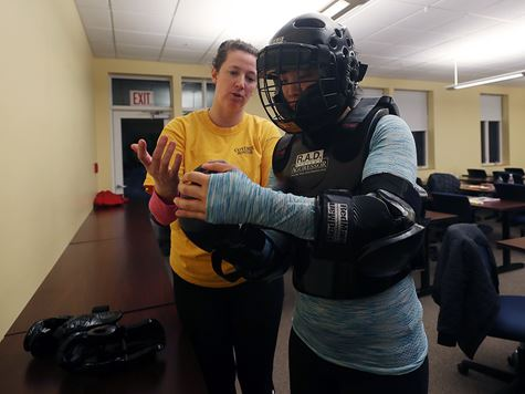Campus Safety RAD training instructor with student in padded suit
