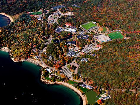 aerial shot of endicott campus during the day with ocean on the left