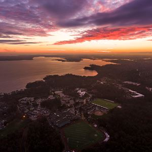 aerial shot of campus with ocean view during sunrise/sunset