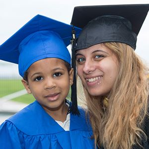 mother and son dressed for graduation from keys to degree program