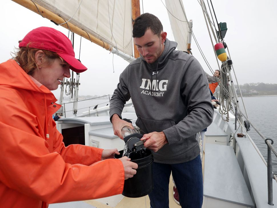 Endicott student and faculty member aboard ship as part of oceanography class