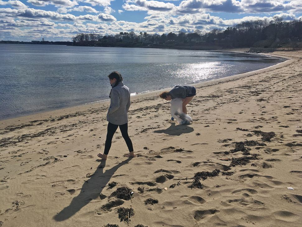 Students conducting beach cleanup