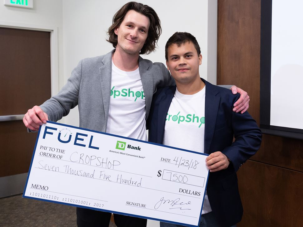 Two Endicott Students  holding a check that they were presented for each of their entrepreneurship entries