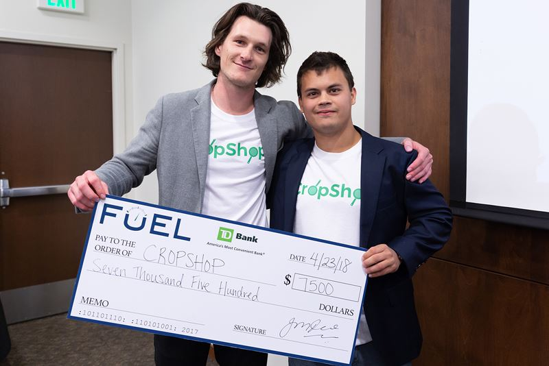 Endicott College Entrepreneurship Spark Tank Winners - two students holding a check