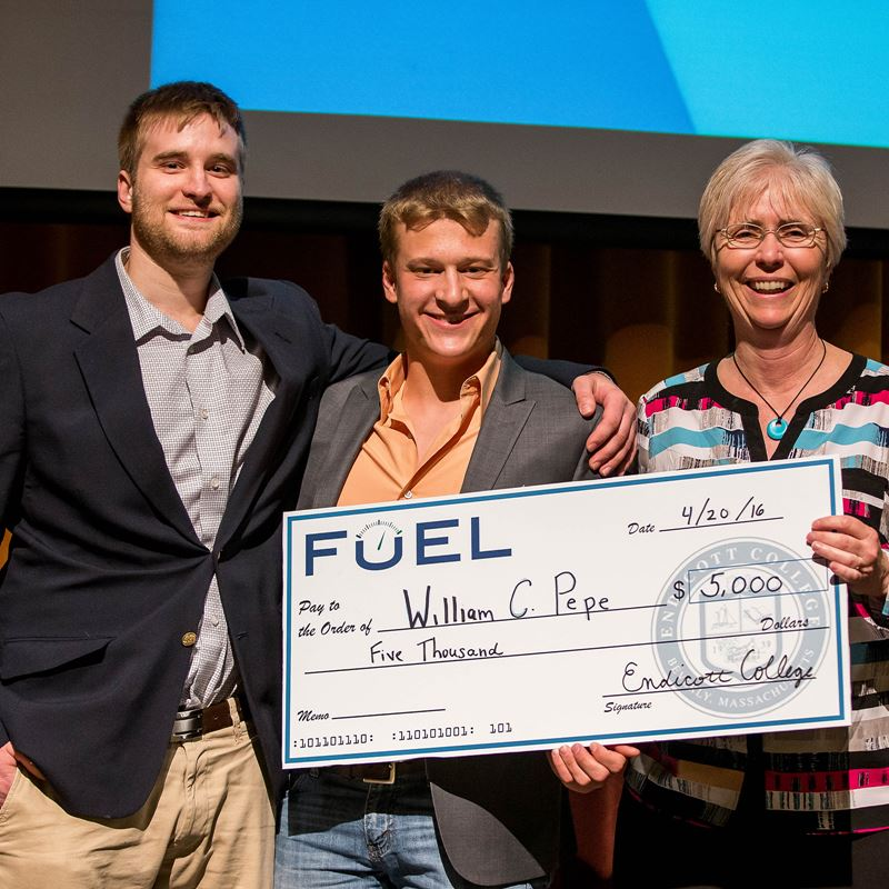 check being presented as prize at FUEL conference