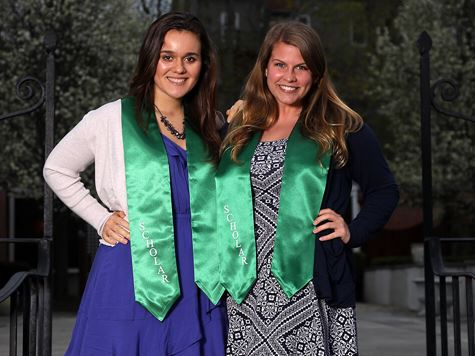 two students at honors gala wearing their honors sashes