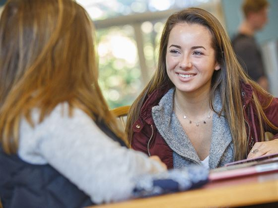 two students socializing in lounge area