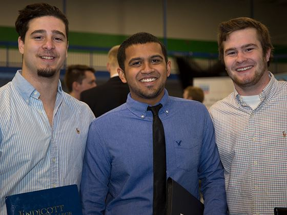 three students dressed up at job/career fair