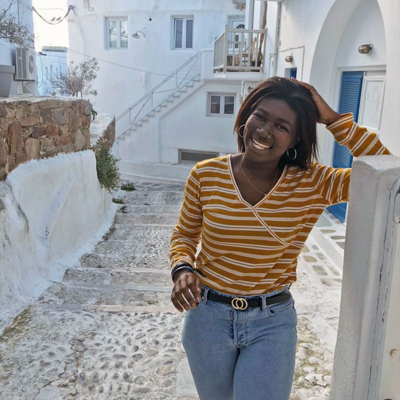 Linda Adarkwah walking the streets of Santorini