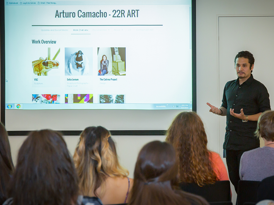 a guy giving a presentation about the work of Arturo Camacho