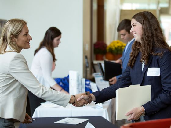Endicott student networks at meet the firm event
