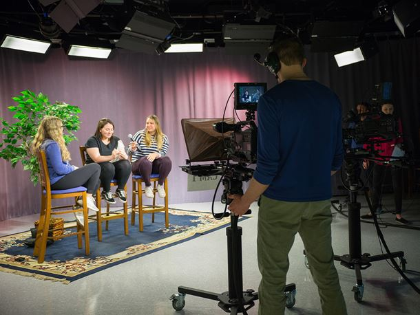 Endicott College students in a TV filming room