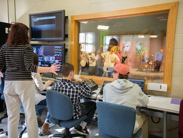 Endicott College students working in a TV production room