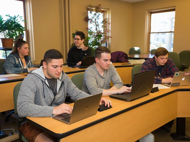 Endicott College students in a communications classroom