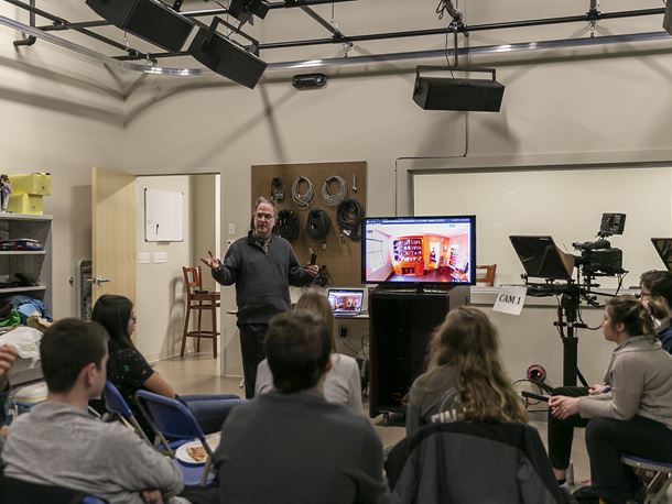 Endicott College students and professor in a VR storytelling class