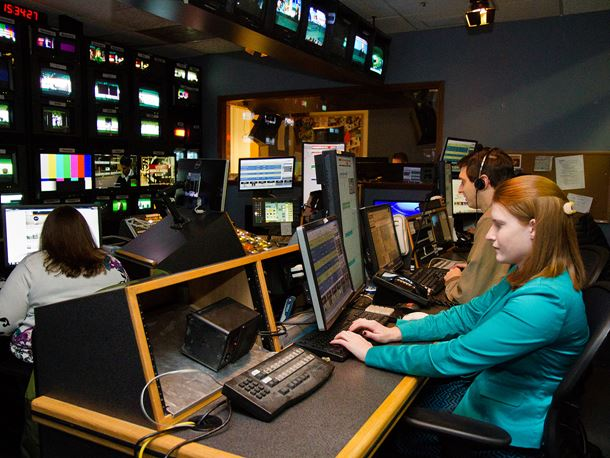 Endicott College students in a TV production room