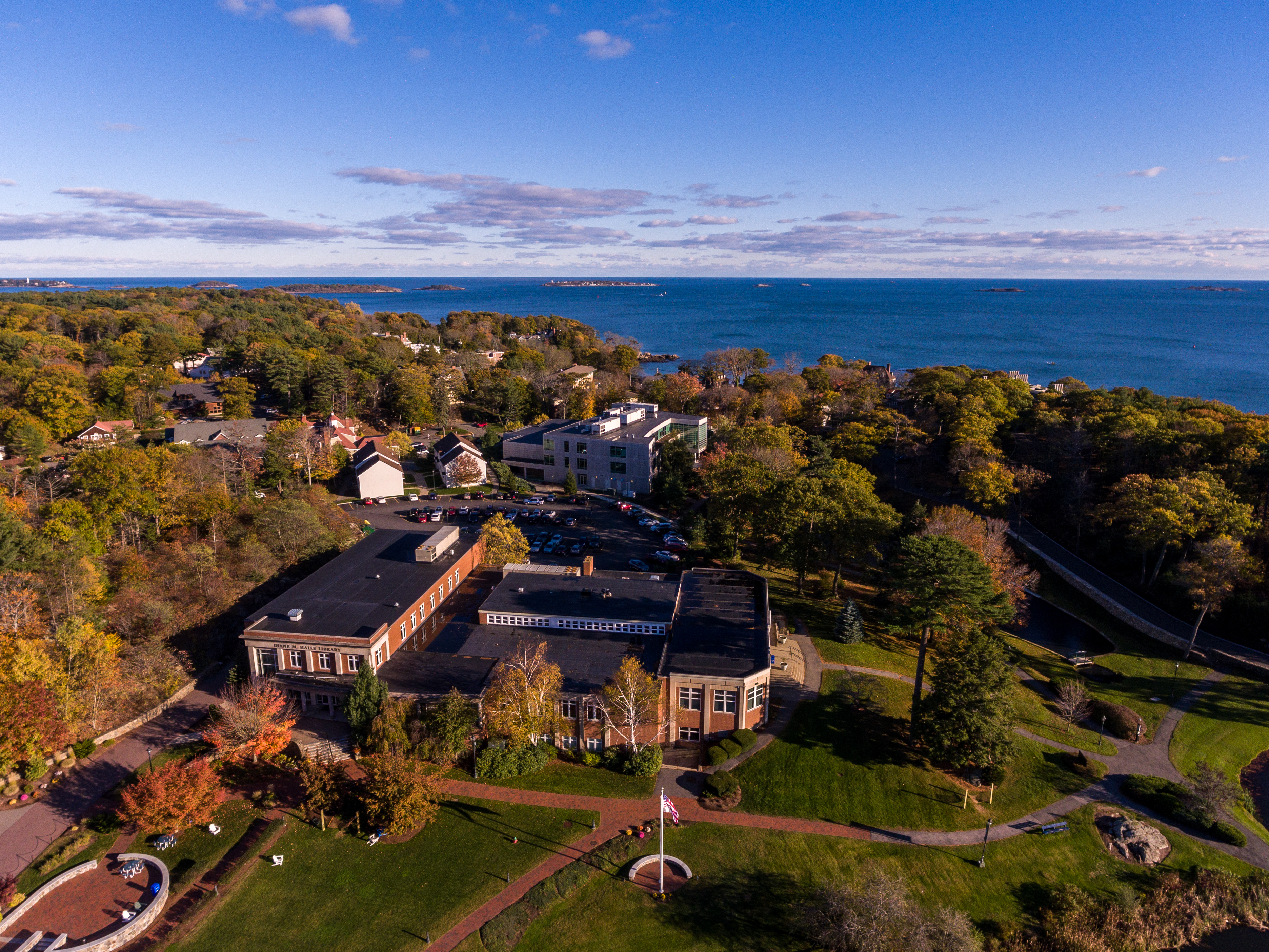 scenic aerial shot of campus with ocean on horizon