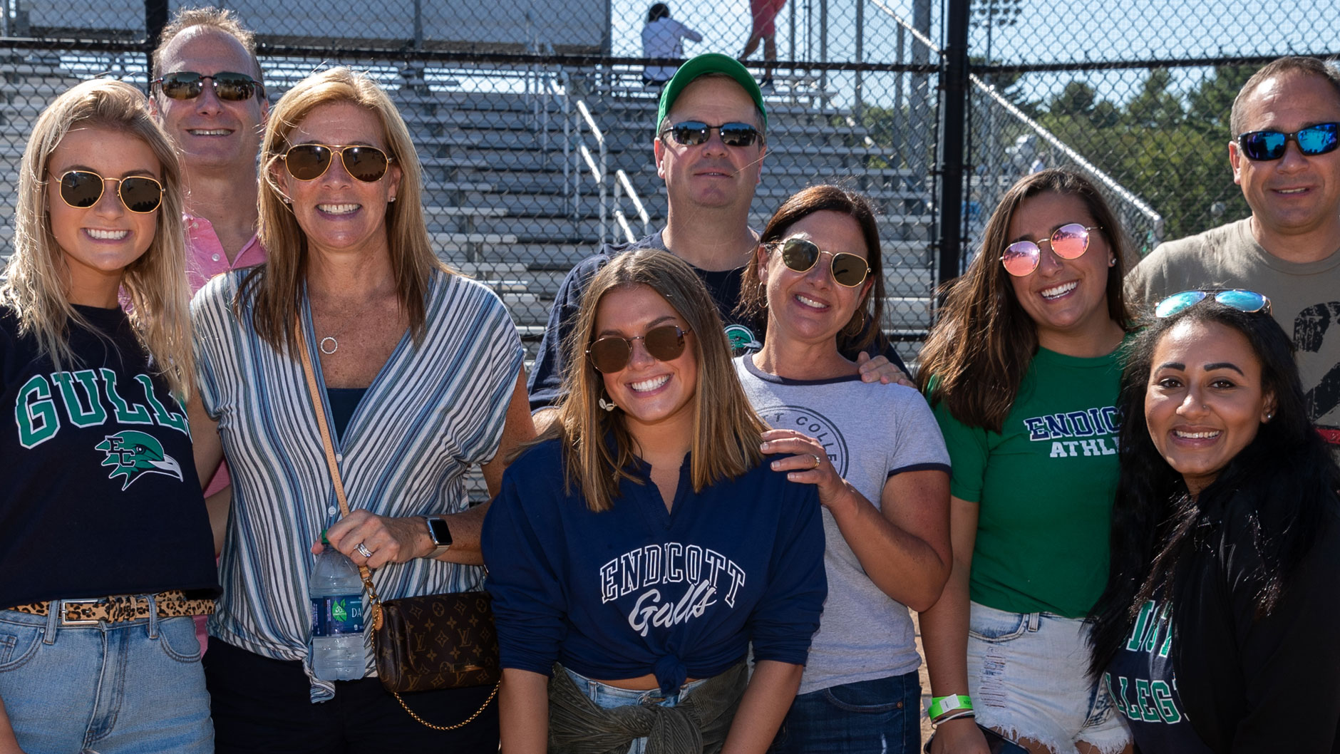 A group of alumni and families pose during Homecoming & Family Weekend