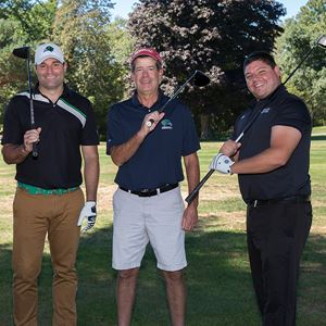 photograph of group of men participating in endicott golf tournament