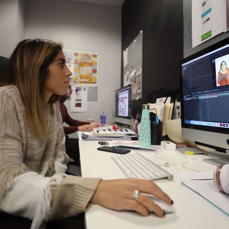 Alexandra Del Tufo works on design work at her semester-long internship site, King Fish Media