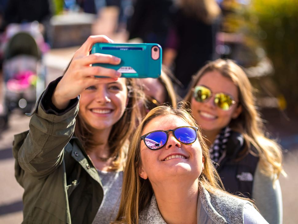Students taking a selfie at Homecoming and Family Weekend.