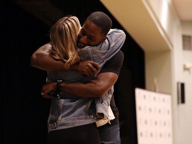 Ken E. Nwadike Jr., founder of the Free Hugs Project, gives a hug to a student as part of his message of peace.
