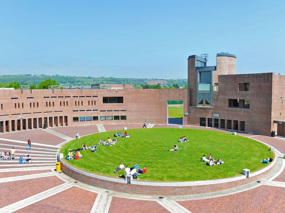 Cork Institute of Technology campus with students sitting on lawn