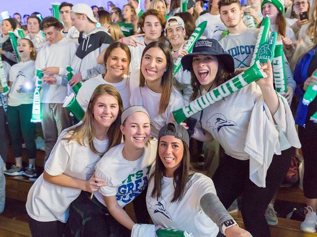 Students in Endicott Gear cheer on their friends in the basketball game.