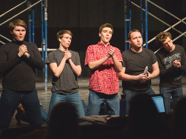 students perform West Side Story on stage