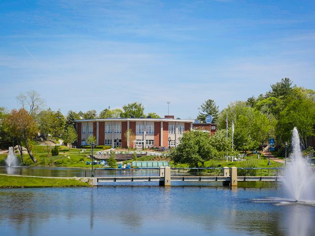 A summer Endicott College campus view of the ponds and the Wax Academic Center.