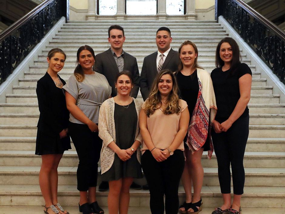 Campaign Planning Students stand on the stairs of the State House.