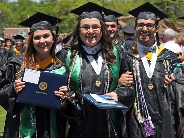 Students with diplomas following graduation ceremony