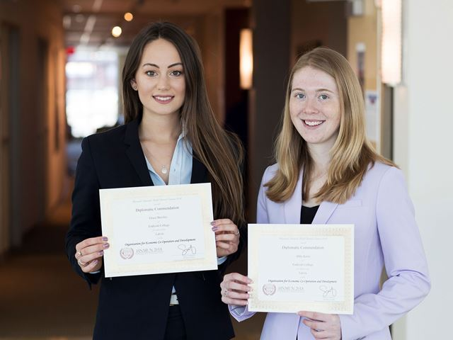 Grace Beesley '19 and Abigail Keim '19 hold their Diplomatic Commendation Awards.