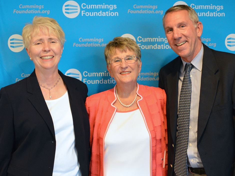 Joyce Cummings stands with Deirdre Sartorelli and David Vigneron of Endicott College