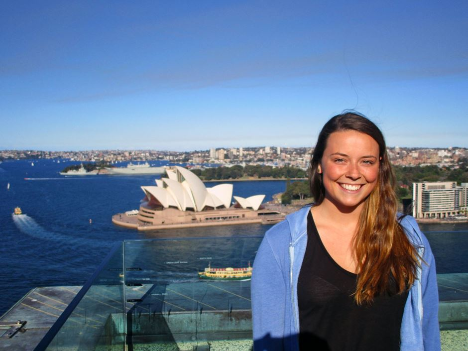 Student posing with the Sydney Opera House in the background