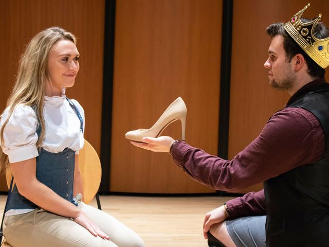 Two actors perform a scene from Into The Woods. Cinderella (played by Meaghan DelGenio) is presented her missing slipper by the proud Prince (Michael Varno). Photo credit: Nicole Sigrist