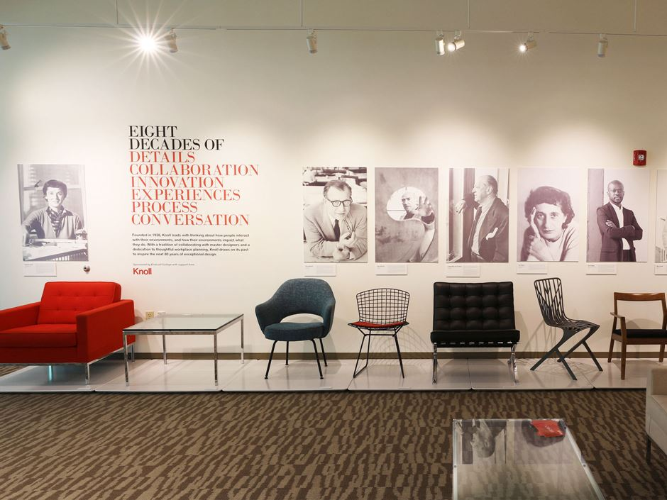 Image shows a line of chairs and images as part of the exhibit on Knoll furniture and design