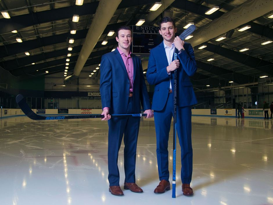 Carter Horowitz and Michael Heidkamp dressed in suits on the ice