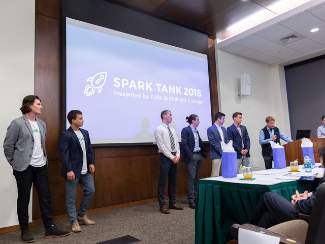 Finalists from last year's Spark Tank standing in the Klebanoff Auditorium waiting for the results of the competition.