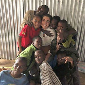 Emma Roca '21 posing with a group of students she taught in Africa