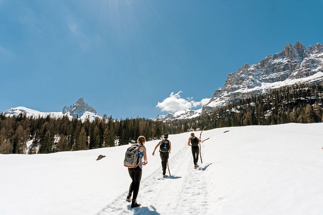Three students hiking up the Italian Dolomites in Cortina