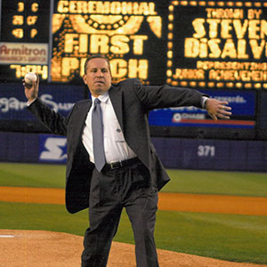 Dr. DiSalvo throwing out the first pitch at a New York Mets game on May 21, 2003