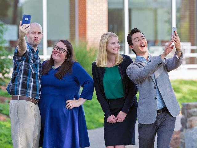 Residence Life area directors taking selfies