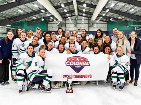 Women's hockey posing with their CHC championship trophy