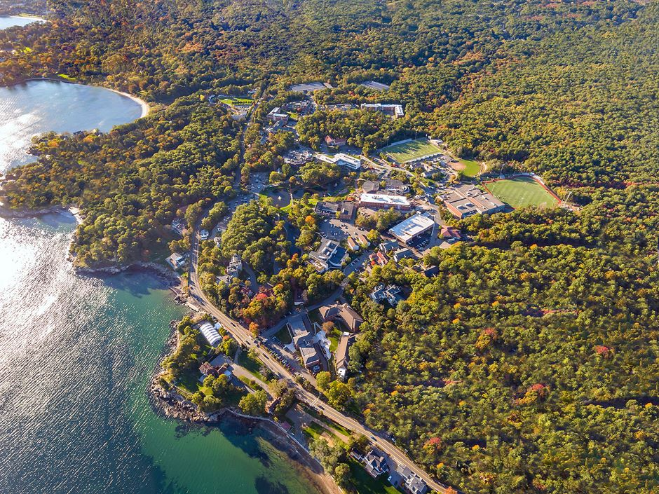 Aerial shot of Endicott College campus and ocean coastline.