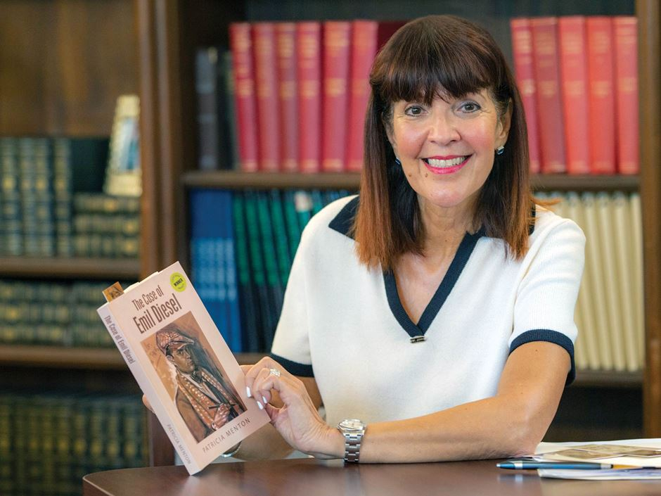 Endicott alumna Patricia Scangas holds her book