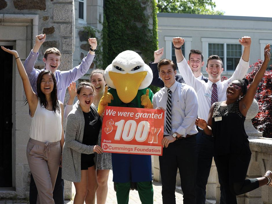 Endicott students and the Gull with a $100K for 100 program sign