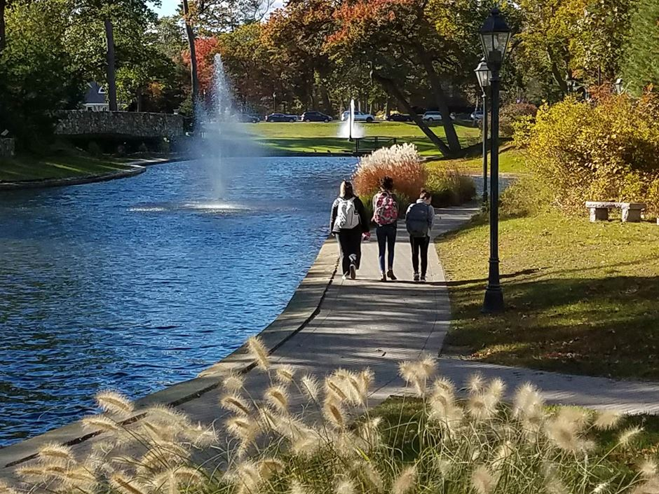 Endicott students walk by campus lakes