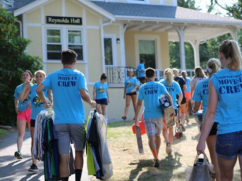 students moving into residence hall during first week of school