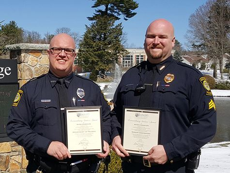 two endicott cops holding up certificates